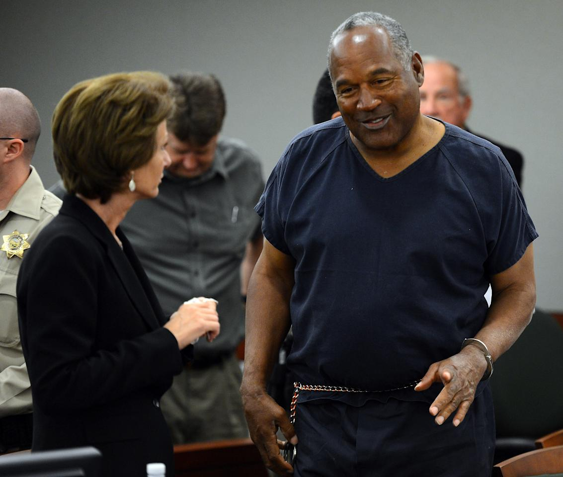 LAS VEGAS, NV - MAY 14:  O. J. Simpson (R) talks to his defense attorney Patricia Palm during a break in an evidentiary hearing in Clark County District Court on May 14, 2013 in Las Vegas, Nevada. Simpson, who is currently serving a nine-to-33-year sentence in state prison as a result of his October 2008 conviction for armed robbery and kidnapping charges, is using a writ of habeas corpus to seek a new trial, claiming he had such bad representation that his conviction should be reversed.  (Photo by Ethan Miller/Getty Images)