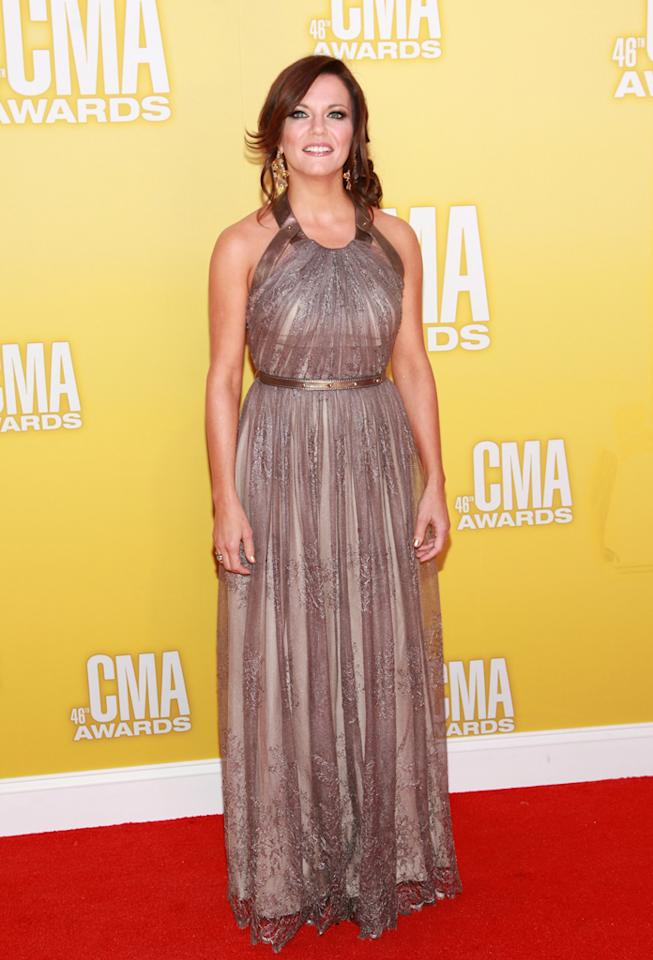 "<p class=""MsoNormal"">Female Vocalist of the Year nominee Martina McBride was a golden girl in a Grecian-style gown featuring leather straps and a belt, which set off her red locks. ""I just wanna say I am so grateful and happy,"" she tweeted on her way to awards show. ""Happy to be a part of 2nite and grateful 2 all my fans and friends."" (11/1/2012)</p>"