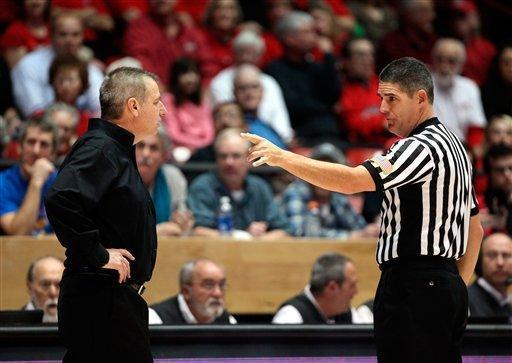 Colorado State head basketball coach Larry Eustachy, left, is ordered back to his bench by game official Mike Reed in the second half against New Mexico in their NCAA basketball game in Albuquerque, N.M., Wednesday, Jan. 23, 2013. New Mexico won 66-61. (AP Photo/Eric Draper)