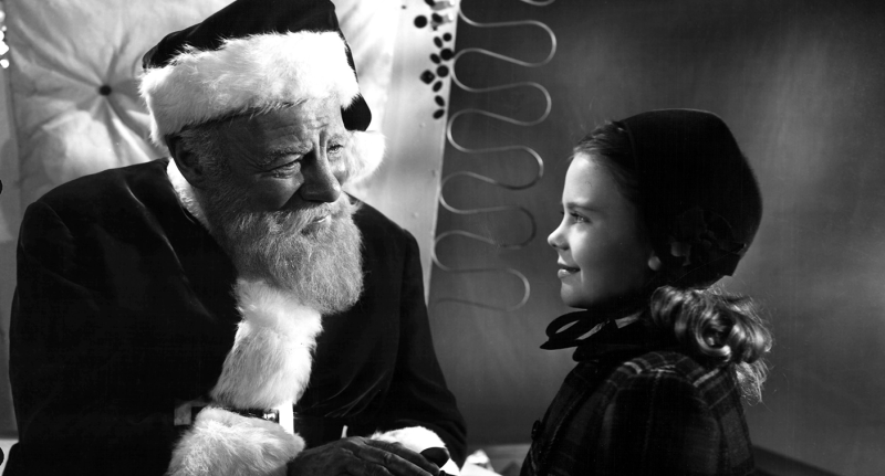 Santa and a little girl in a movie still from 'Miracle on 34th Street'