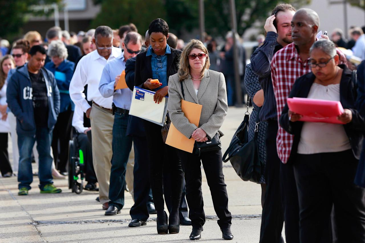 People wait in line to enter the Nassau County Mega Job Fair at Nassau Veterans Memorial Coliseum in Uniondale, New York October 7, 2014. U.S. job openings rose to their highest level in more than 13 years in August even as hiring fell, the U.S. Department of Labor said. REUTERS/Shannon Stapleton/File Photo
