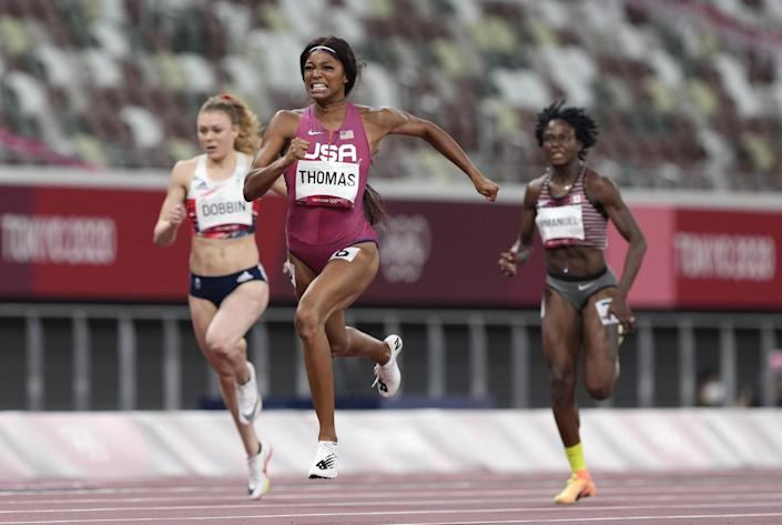 Gabrielle Thomas runs ahead of two opponents.
