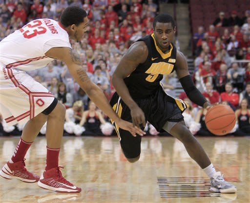 Iowa's Anthony Clemmons, right, drives to the basket around Ohio State's Amir Williams during the first half of an NCAA college basketball game Tuesday, Jan. 22, 2013, in Columbus, Ohio. (AP Photo/Jay LaPrete)