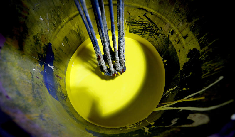 Yellow paint is stirred at the Mylands factory in London, Thursday, Oct. 24, 2019.  As politicians continue to squabble over how and when Britain will leave the EU, Brexit is already reshaping the economy for businesses like Mylands paint factory, as they build up stocks in Germany to overcome potential delays to European customers, according to CEO Dominic Mylands. (AP Photo/Frank Augstein)