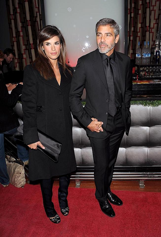 "Speaking of hunks, George Clooney looked downright delicious in an all-black ensemble upon arriving at the New York Film Critic's Circle Awards alongside his current lady love, Italian model/""actress"" Elisabetta Canalis. Stephen Lovekin/<a href=""http://www.gettyimages.com/"" target=""new"">GettyImages.com</a> - January 11, 2010"
