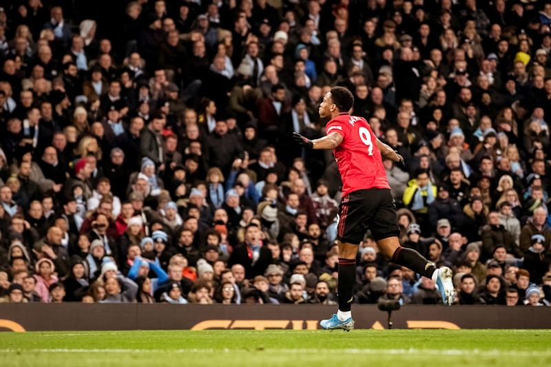 MANCHESTER, ENGLAND - DECEMBER 07: Anthony Martial of Manchester United celebrates scoring their second goal during the Premier League match between Manchester City and Manchester United at Etihad Stadium on December 07, 2019 in Manchester, United Kingdom. (Photo by Ash Donelon/Manchester United via Getty Images)