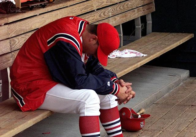 Rick Ankiel sits dejected in the dugout after leaving the April 14, 2001, game against the Astros. (AP)