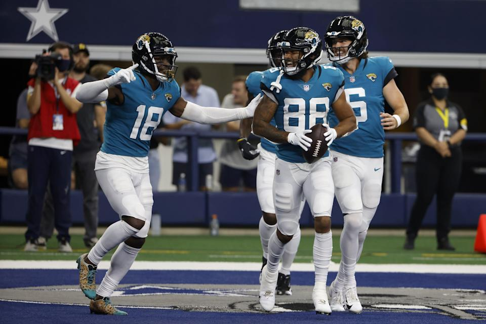 Jaguars' Laquon Treadwell (18) and Jeff Cotton (88) celebrate a touchdown catch made by Treadwell in the second half of a preseason against the Cowboys.