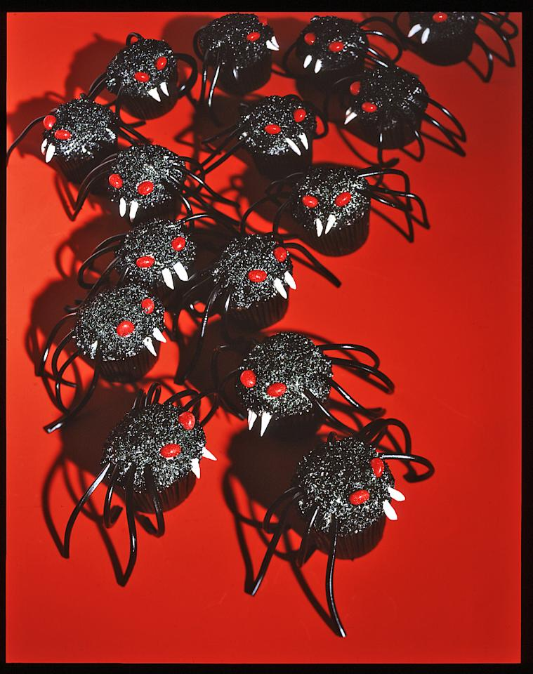 """<p>Lock your oven doors! Mutant spiders (mini cupcakes coated with black sanding sugar) are coming to be devoured. Terrifying but delicious, everyone will love the special effects&mdash;cinnamon-candy eyes, <a href=""""https://www.marthastewart.com/276327/marshmallow-recipes"""">marshmallow</a> fangs, and licorice legs.</p>"""