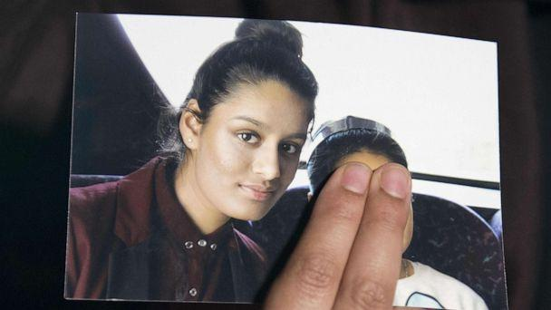 PHOTO: (FILES) In this file photo taken on February 22, 2015 Renu, eldest sister of missing British girl Shamima Begum, holds a picture of her sister while being interviewed by the media in central London, on February 22, 2015. (Laura Lean/POOL/AFP via Getty Images)