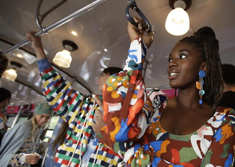 Models wear creations onboard a tram as part of Missoni's retro spring/summer 2020 collection.