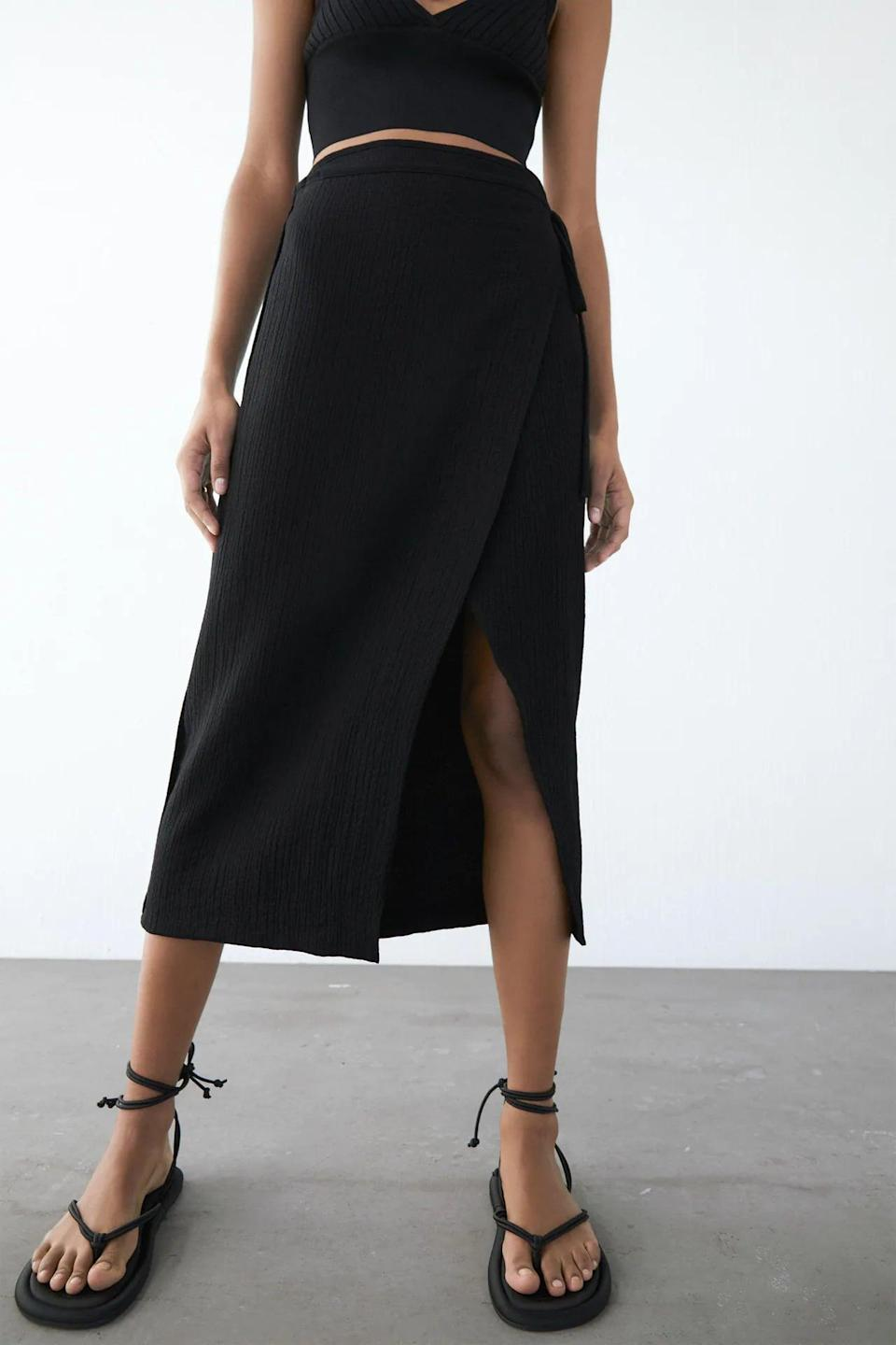<p>A fun slit and sleek profile give this <span>Textured Weave Wrap Skirt</span> ($40) a modern look.</p>
