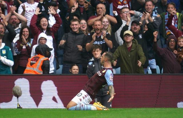 Danny Ings slides on his knees after scoring for new club Aston Villa