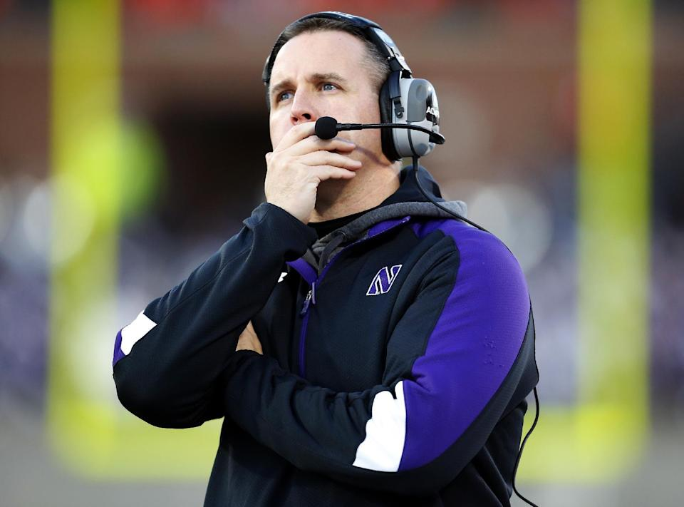 Northwestern head coach Pat Fitzgerald watches the scoreboard during the first half of an NCAA college football game against Illinois on Saturday, Nov. 30, 2013, in Champaign, Ill. (AP Photo/Jeff Haynes)