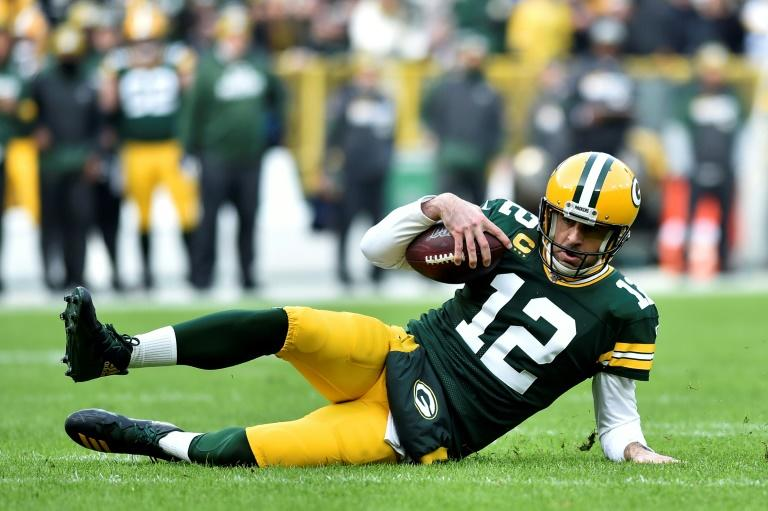 Green Bay quarterback Aaron Rodgers slides for a first down in the Packers' NFL victory over the Washington Redskins (AFP Photo/Quinn Harris)