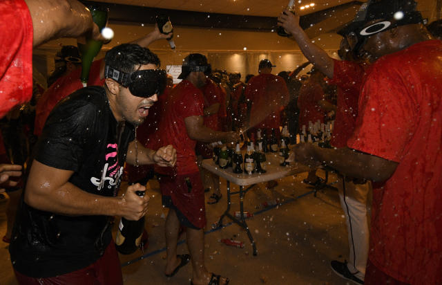 Washington Nationals' Gio Gonzalez, left, and others celebrate in the locker room after they clinched the National League East title after a baseball game against the Philadelphia Phillies, Sunday, Sept. 10, 2017, in Washington. (AP Photo/Nick Wass)