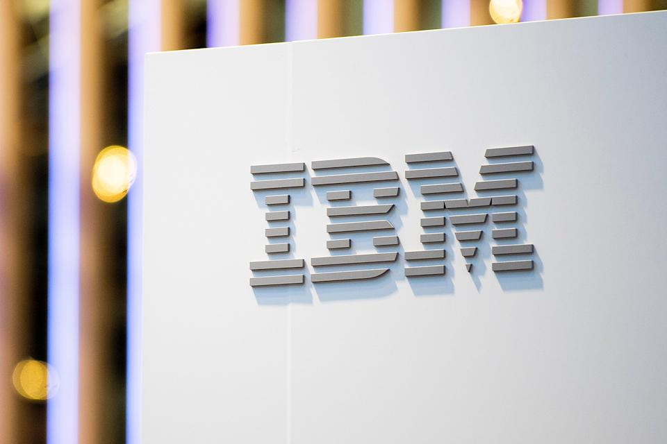 A logo sits illumintated outside the IBM booth on day 2 of the GSMA Mobile World Congress 2019 (Getty Images)