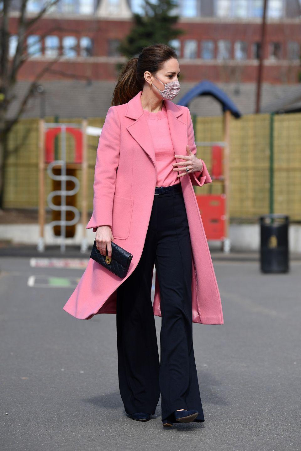 <p>It was only natural that someone who puts such care into her looks as Kate does would choose a protective face mask to match her salmon pink coat and shirt. </p>