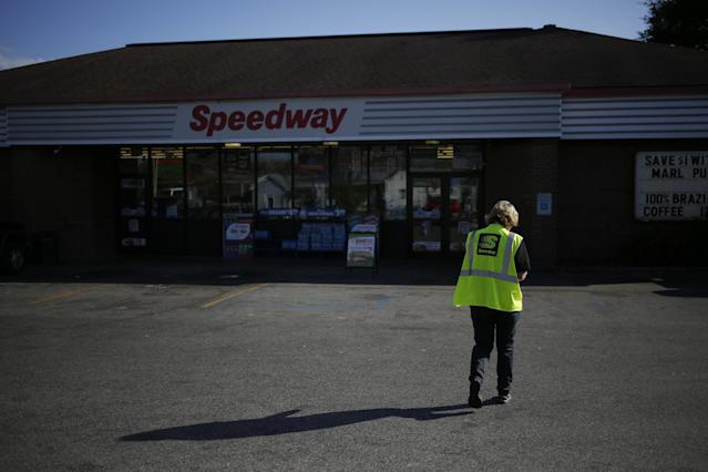 An employee walks through the parking lot of a Marathon Petroleum Corp. Speedway gas station in Huntington, West Virginia, in 2016. Marathon Petroleum Corp. paid its CEO 935 times more than it paid its median employee in 2017, according to a new disclosure. (Bloomberg via Getty Images)