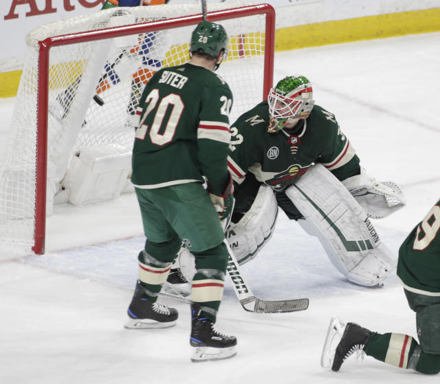Minnesota Wild defenseman Ryan Suter (20) looks on as New York Islanders center Brock Nelson (29), not pictured, scores the winning goal in overtime against Minnesota Wild goaltender Alex Stalock (32) in an NHL hockey game Sunday, March 17, 2019, in St. Paul, Minn. The Islanders won 3-2. (AP Photo/Paul Battaglia)