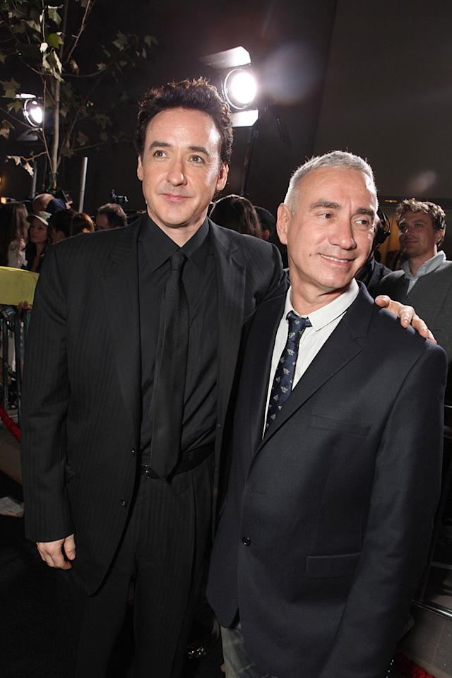 """<a href=""""http://movies.yahoo.com/movie/contributor/1800019276"""">John Cusack</a> and director <a href=""""http://movies.yahoo.com/movie/contributor/1800022583"""">Roland Emmerich</a> at the Los Angeles premiere of <a href=""""http://movies.yahoo.com/movie/1810045661/info"""">2012</a> - 11/03/2009"""