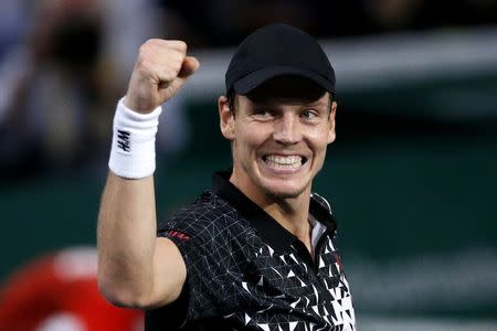 Tomas Berdych of the Czech Republic celebrates defeating Kevin Anderson of South Africa in his men's singles quarter-final tennis match at the Paris Masters tennis tournament at the Bercy sports hall in Paris, October 31, 2014. REUTERS/Benoit Tessier