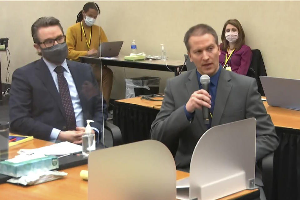 FILE - In this April 15, 2021, file image from video, defense attorney Eric Nelson, left, and defendant, former Minneapolis police officer Derek Chauvin, address Hennepin County Judge Peter Cahill at the Hennepin County Courthouse in Minneapolis, Minn. Nelson is asking that the judge sentence Chauvin, convicted of murder in the death of George Floyd, to probation and time already served, probationary sentence, limiting his incarceration to time served, or in the alternative, a downward durational departure in crafting its sentence for Mr. Chauvin. (Court TV via AP, Pool File)