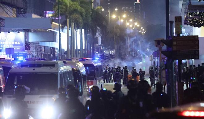Police officers fire tear gas rounds at Tsim Sha Tsui as Christmas Eve protests break out in Hong Kong. Photo: May Tse