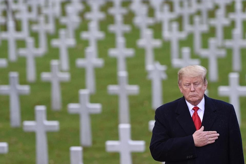 US President Donald Trump takes part in a ceremony at the American Cemetery of Suresnes, outside Paris, on November 11, 2018 as part of Veterans Day and commemorations marking the 100th anniversary of the 1918 armistice ending World War I (AFP Photo/Saul LOEB)