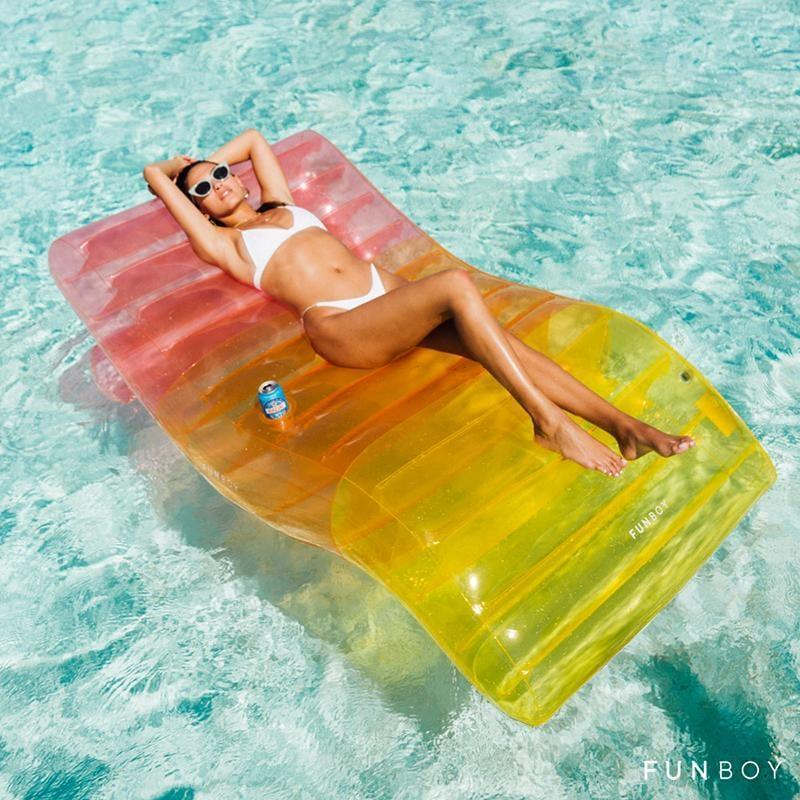 <p>Brighten up your pool with this vibrant <span>Funboy Clear Rainbow Chaise Lounger</span> ($79). You can even use this as a relaxing lounger on land!</p>