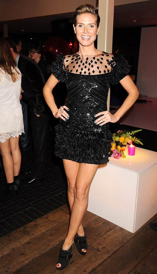 "Another fan of the little black dress ... ""Project Runway"" hostess with the mostest Heidi Klum, who attended <i>InStyle's</i> ""Best of British Talent"" fete in a shiny Marchesa mini that featured trendy feathers on the shoulders and skirt. Dave M. Benett/<a href=""http://www.gettyimages.com/"" target=""new"">GettyImages.com</a> - January 25, 2011"