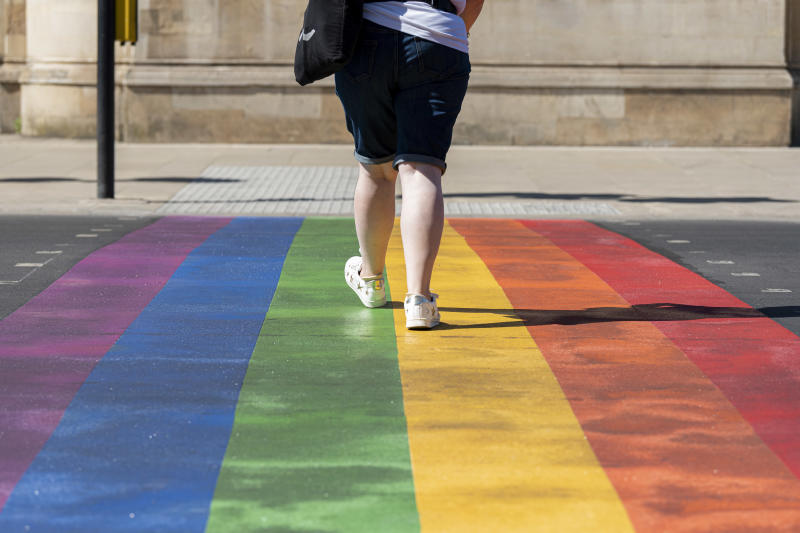 LONDON, UNITED KINGDOM - 2020/05/30: A woman uses the first permanent rainbow crossing to show support for the Wandsworth borough's LGTBQ+ community outside the iconic Battersea Arts Centre on Lavender Hill. The rainbow features the colours of the internationally recognised Pride Flag which has come to symbolise diversity and pride of the LGBTQ+ community worldwide. (Photo by Dave Rushen/SOPA Images/LightRocket via Getty Images)