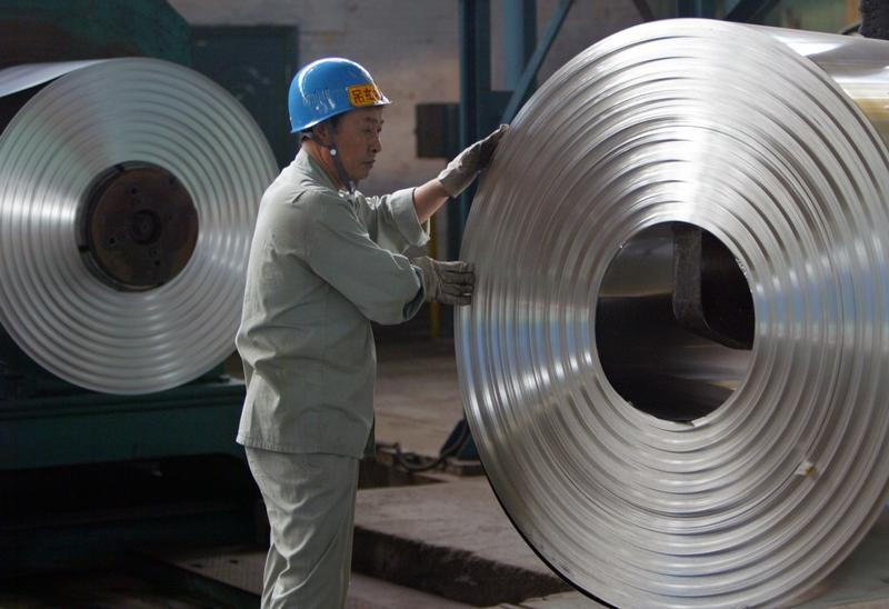 Labourer works at cold-rolling mill of Wuhan Iron & Steel Group on outskirts of Wuhan