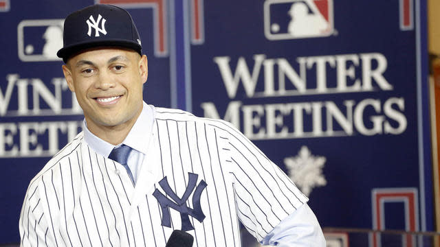 Giancarlo Stanton is happy to leave behind the Miami Marlins to join the New York Yankees. (AP)