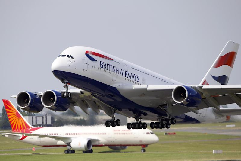 A British Airways Airbus A380, right, takes off in front of an Air India Boeing 787 Dreamliner during the first day of the 50th Paris Air Show at Le Bourget airport, north of Paris, Monday, June 17, 2013. (AP Photo/Francois Mori)