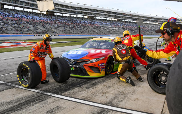Kyle Busch's pit crew services his car during a NASCAR Cup Series auto race at Texas Motor Speedway, Sunday, Nov. 3, 2019, in Fort Worth, Texas. (AP Photo/Larry Papke)