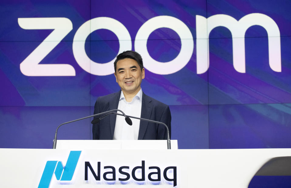 Zoom CEO Eric Yuan attends the opening bell at Nasdaq as his company holds its IPO in New York. (AP Photo/Mark Lennihan, File)