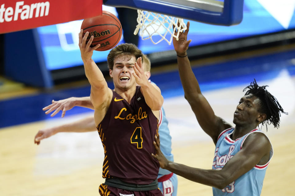 Loyola of Chicago guard Braden Norris (4) drives to the basket ahead of Drake forward Issa Samake, right, during the second half of an NCAA college basketball game, Saturday, Feb. 13, 2021, in Des Moines, Iowa. (AP Photo/Charlie Neibergall)