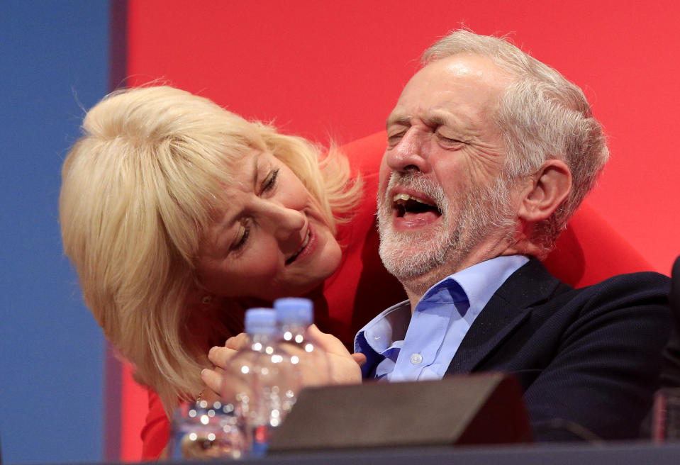 Labour leader Jeremy Corbyn laughs next to Jennie Formby during the second day of the Labour Party conference in Brighton, Sussex.
