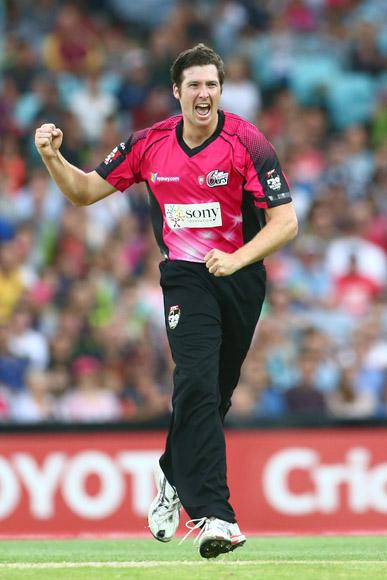 Luke Feldman of the Sixers celebrates taking the wicket of Chris Rogers of the Thunder during the Big Bash League match between Sydney Thunder and the Sydney Sixers at ANZ Stadium on December 30, 2012 in Sydney, Australia.  (Photo by Mark Kolbe/Getty Images)
