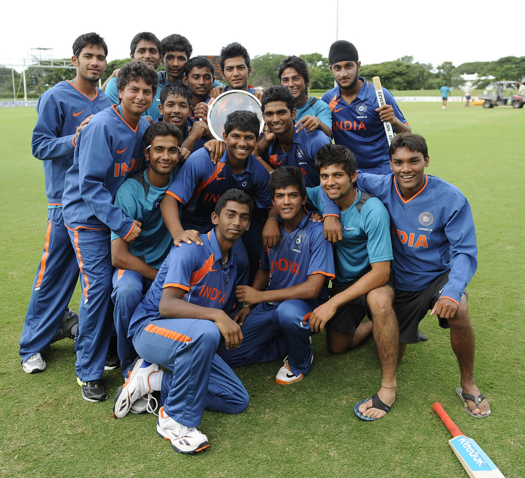TOWNSVILLE, AUSTRALIA - APRIL 15:  The Indian team pose for a photograph after winning  the match between Australia and India on day five of the U19 International Quad Series at Tony Ireland Stadium on April 15, 2012 in Townsville, Australia.  (Photo by Ian Hitchcock/Getty Images)