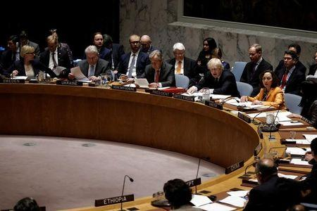 British Foreign Secretary Boris Johnson sits next to United Nations Secretary General Antonio Guterres as Johnson chairs a U.N. Security Council meeting on South Sudan at U.N. headquarters in New York City