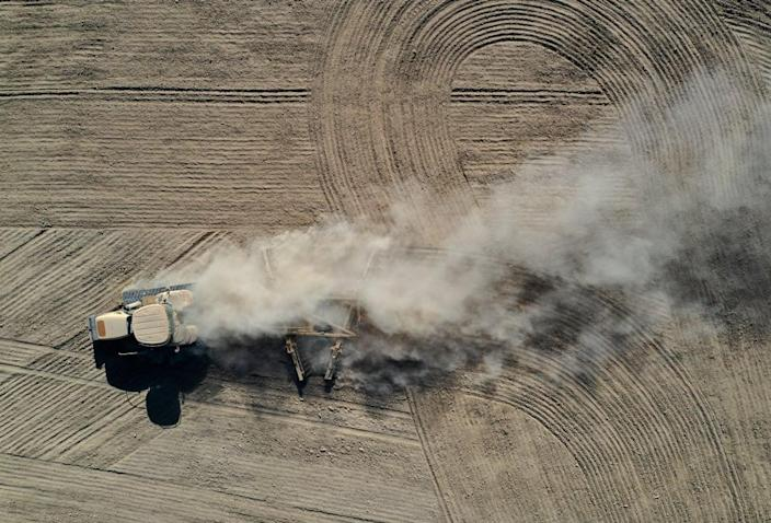 """<div class=""""inline-image__title"""">1320208440</div> <div class=""""inline-image__caption""""><p>A tractor kicks up dust as it plows a dry field on May 26, 2021 in Chowchilla, California. As California enters an extreme drought emergency, water is starting to become scarce in California's Central Valley, one of the most productive agricultural regions in the world. </p></div> <div class=""""inline-image__credit"""">Justin Sullivan/Getty</div>"""