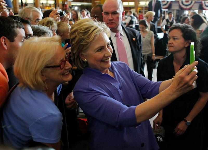 Democratic Presidential candidate Hillary Clinton take selfies with campaign supporters after her speech at campaign rally at the Cincinnati Museum Center at Union Terminal June 27, 2016, in Cincinnati, Ohio.