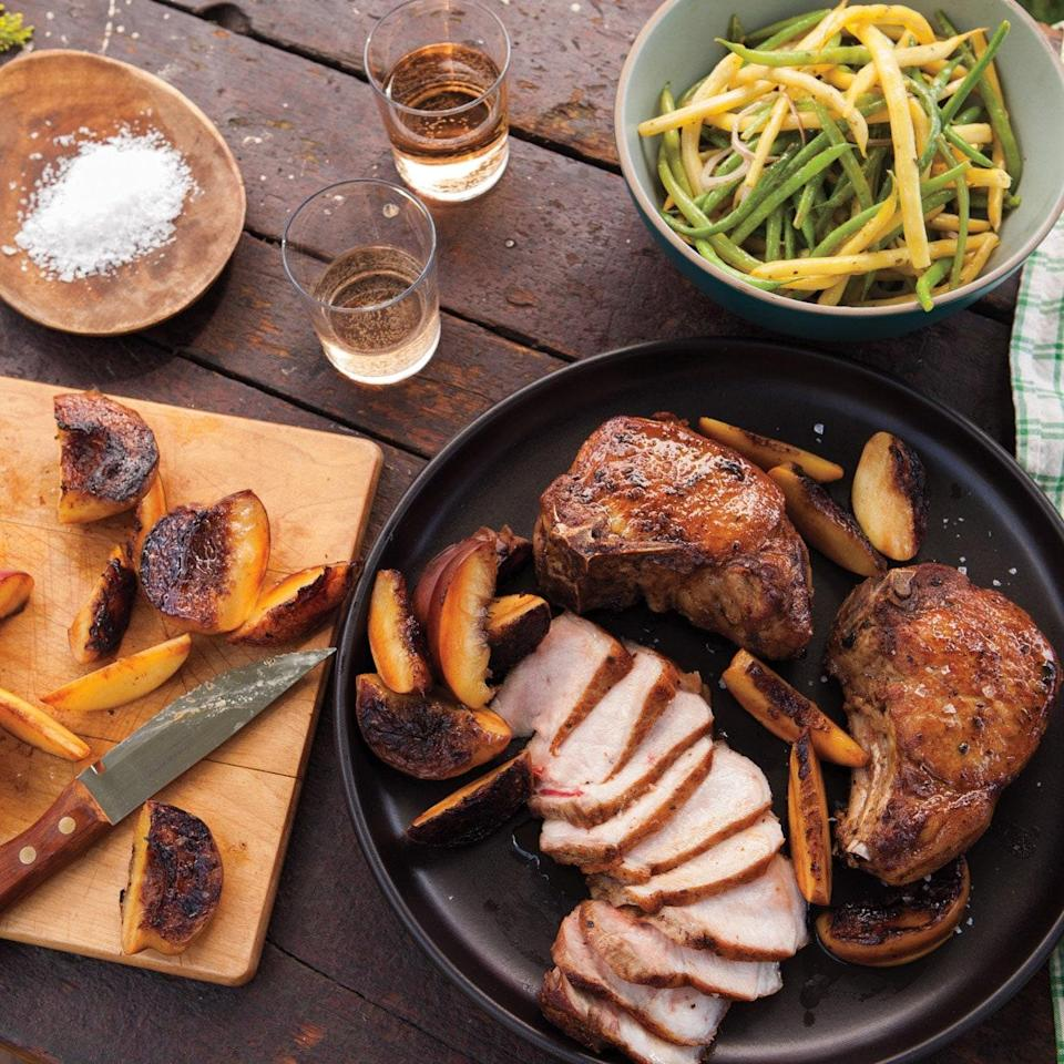 """These pork chops cook in a jiffy; don't skip the grilled peaches or bean salad served alongside them. You'll divide the mustardy marinade for the pork in half and use some of it as a dressing for the beans. <a href=""""https://www.epicurious.com/recipes/food/views/grilled-pork-chops-with-peaches-and-pole-beans-395917?mbid=synd_yahoo_rss"""" rel=""""nofollow noopener"""" target=""""_blank"""" data-ylk=""""slk:See recipe."""" class=""""link rapid-noclick-resp"""">See recipe.</a>"""