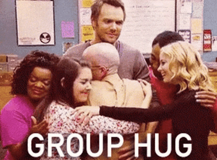 """The cast of """"Community"""" participating in a group hug"""