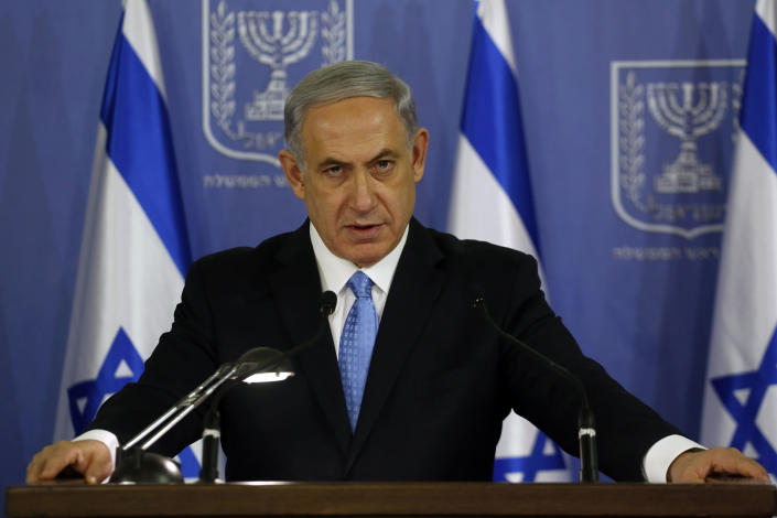 Israeli Prime Minister Benjamin Netanyahu speaks during a joint press conference at the defense ministry in the coastal city of Tel Aviv on August 2, 2014 (AFP Photo/Gali Tibbon)