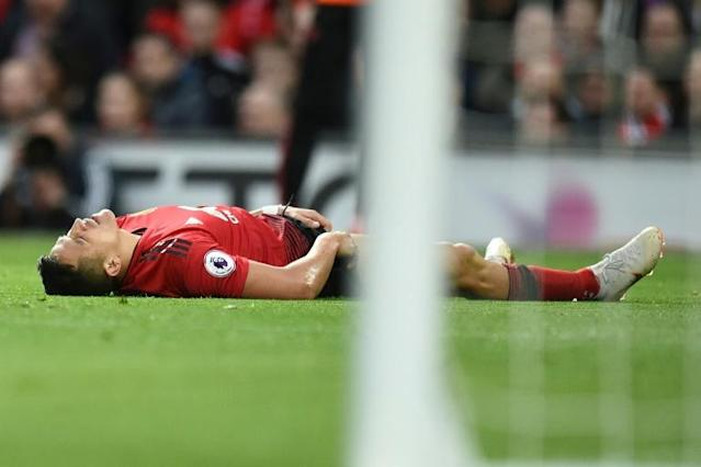 Floored: Injuries took their toll on Alexis Sanchez's ill-fated time at Manchester United (AFP Photo/Oli SCARFF )