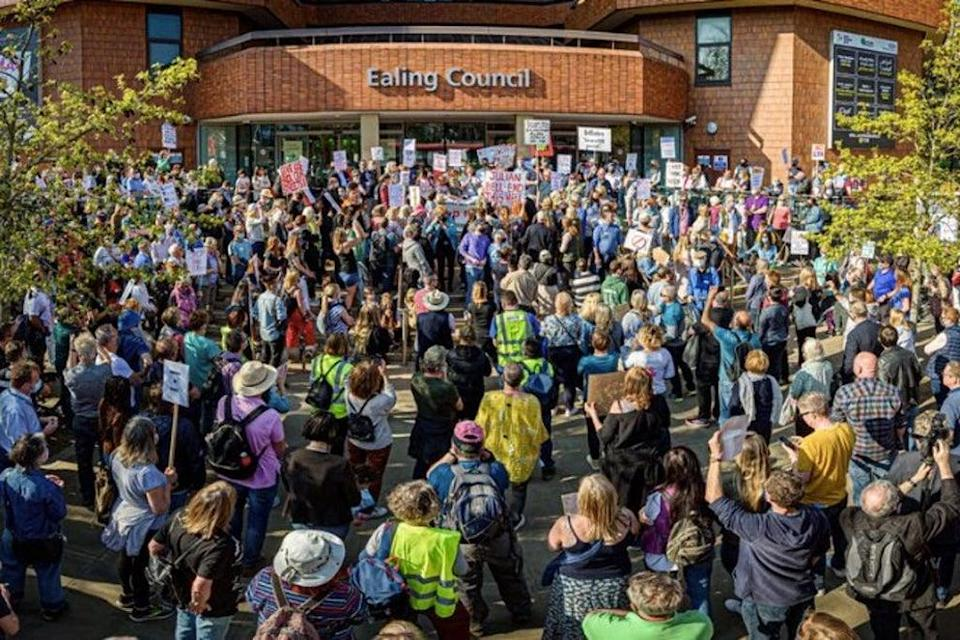 Hundreds of protestors surrounded Ealing Town Hall.  (PA)