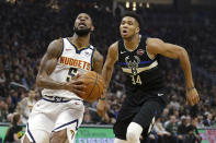 Denver Nuggets' Will Barton drives to the basket against Milwaukee Bucks' Giannis Antetokounmpo (34) during the first half of an NBA basketball game Friday, Jan. 31, 2020, in Milwaukee. (AP Photo/Aaron Gash)